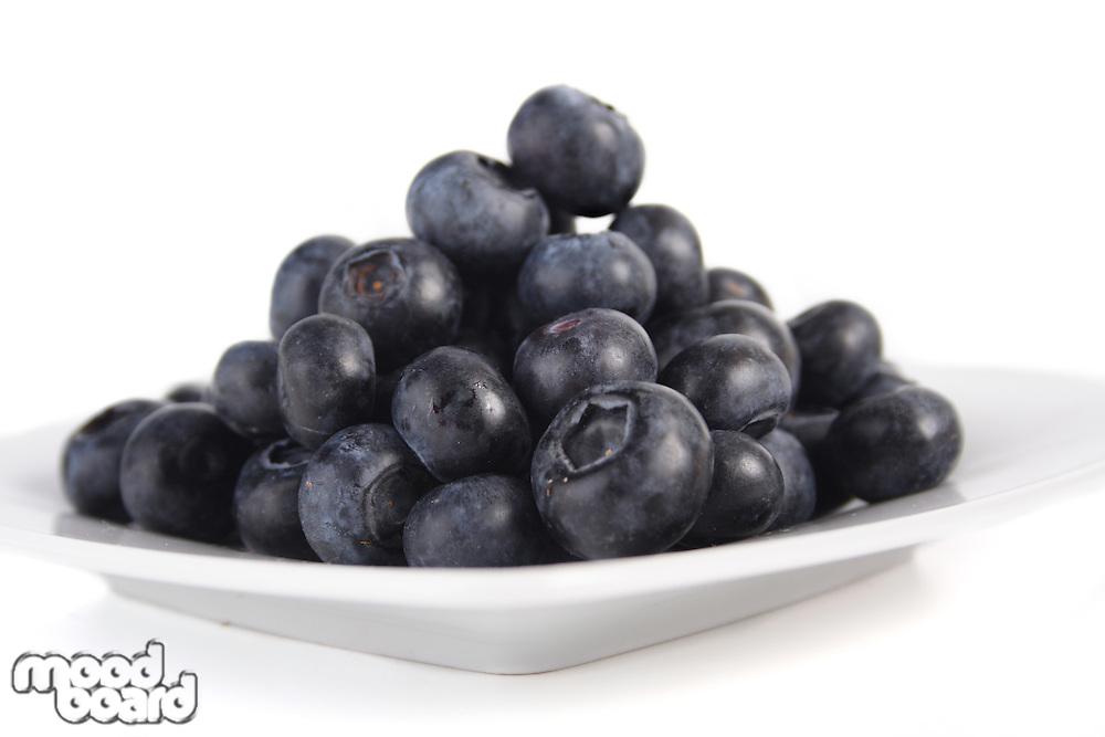 Blueberries on white pot - studio shot