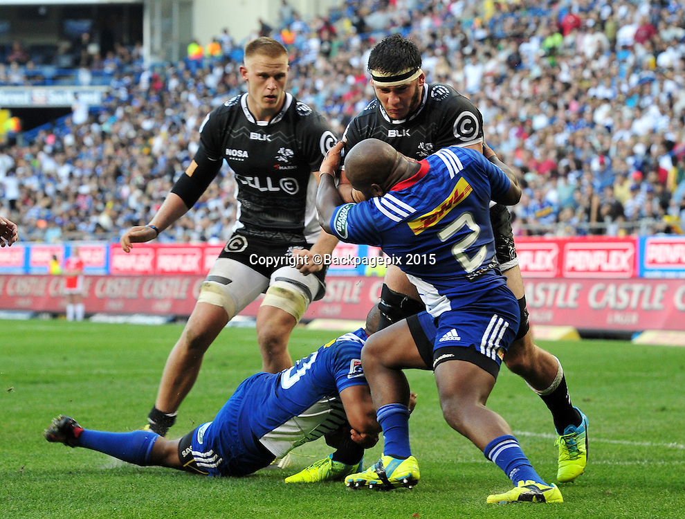 Kurt Coleman and Mbongeni Mbonambi of the Stormers combine to tackle Marcell Coetzee of the Sharks during the 2016 Super Rugby match between the Stormers and the Sharks at Newlands Stadium, Cape Town on 12 March 2016 ©Ryan Wilkisky/BackpagePix