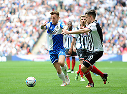 Bristol Rovers' Matty Taylor is challenged by Grimsby's Carl Magnay - Photo mandatory by-line: Neil Brookman/JMP - Mobile: 07966 386802 - 17/05/2015 - SPORT - football - London - Wembley Stadium - Bristol Rovers v Grimsby Town - Vanarama Conference Football