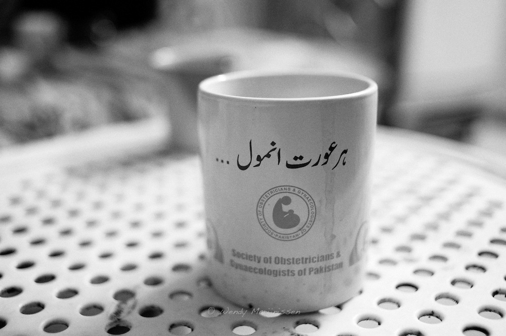 The slogan 'Every woman is priceless' written on doctor Musarats' tea cup is a reminder of why she does her job. Karachi, Pakistan, 2010