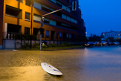 Surfboard in the middle of crossroad full water after heavy rain on September 18, 2010, in Ljubljana, Slovenia. (Photo by Matic Klansek Velej / Sportida)