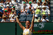 Indian Wells, CA - Flavia Pennetta of Italy celebrates victory against Agnieszka Radwanska of Poland during the BNP Paribas Open.