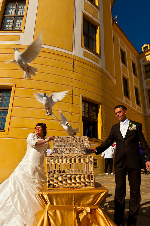 A bride and groom release doves during their wedding ceremony outside the Schloss Moritzburg (castle), Moritzburg, Saxony, Germany
