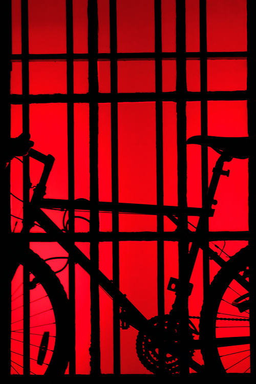 A bicycle on red window
