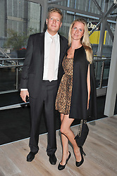 CHLOE DELEVINGNE and ED GRANT at a party to celebrate the publication of her  autobiography - The World According to Joan, held at the British Film Institute, South Bank, London SE1 on 8th September 2011.