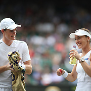 LONDON, ENGLAND - JULY 16: Martina Hingis of Switzerland in action with Jamie Murray of Great Britain during the Mixed Doubles Final on Center Court during the Wimbledon Lawn Tennis Championships at the All England Lawn Tennis and Croquet Club at Wimbledon on July 16, 2017 in London, England. (Photo by Tim Clayton/Corbis via Getty Images)