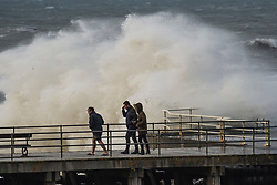 © London News Pictures. 16/10/2017. Aberystwyth, UK. The remnants of storm system Ophelia, with Hurricane Force 12 winds gusting up to 80mph,  batter the sea defences at Aberystwyth on the Cardigan Bay coast of the Irish Sea in west Wales. The Met Office has issued an Amber weather warning, with a good chance that power cuts may occur, with the potential to affect other services, such as mobile phone coverage.. Photo credit: Keith Morris/LNP
