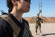 KURDISTAN, NORTHERN IRAQ, Dokuk.<br /> Qalubna Ma'Kum Feature:<br /> Qalubna Ma'kum (meaning &quot;Our hearts are With You&quot;) are a group of foreign volunteer fighters who have joined up with the Peshmerga in Kurdistan to help with the battle against Daesh, also known as ISIS. <br /> <br /> Pictured: Co-founders Kat Argo (left) and Francis Cuvelier (right) on patrol on the southern front lines of Kirkuk, Kurdistan.