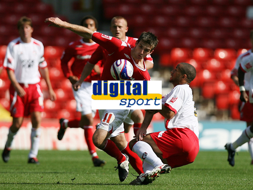 Photo: Rich Eaton. <br /> <br /> Nottingham Forest v AFC Bournemouth. Coca Cola Championship. 11/08/2007. Forest's Scott Dobie (l) is pulled to the ground by Bournemouth's Ryan Garry (r)