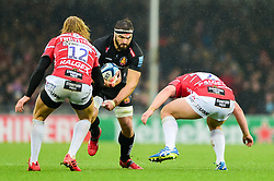 Don Armand of Exeter Chiefs is challenged by Billy Twelvetrees of Gloucester Rugby and Henry Walker of Gloucester Rugby - Mandatory by-line: Ryan Hiscott/JMP - 24/11/2018 - RUGBY - Sandy Park Stadium - Exeter, England - Exeter Chiefs v Gloucester Rugby - Gallagher Premiership Rugby