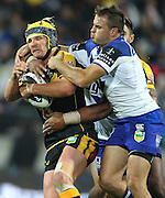 Warriors' Todd Lowrie is tackled during the 2013 NRL season. Vodafone Warriors v Canterbury Bulldogs at Westpac Stadium, Wellington, New Zealand on Saturday 11 May 2013. Photo: Justin Arthur / photosport.co.nz