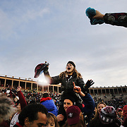 Harvard fans celebrate victory at the end of the game during the Harvard Vs Yale, College Football, Ivy League deciding game, Harvard Stadium, Boston, Massachusetts, USA. 22nd November 2014. Photo Tim Clayton