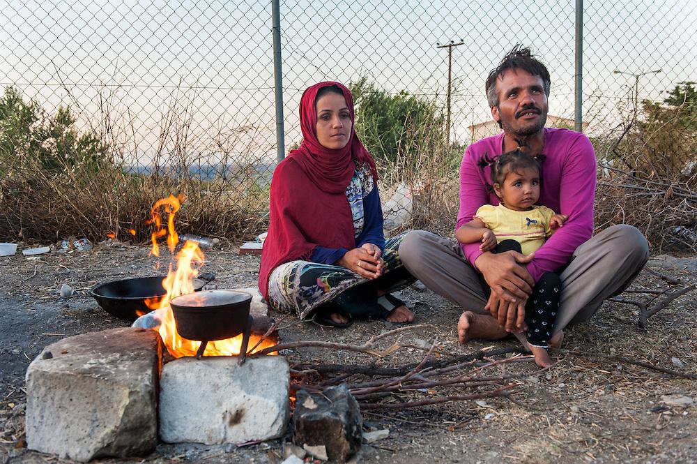 Leila 31 and Jorahan 35 from Kunduz Afghanistan boiling water to make tea in Kara Tepe camp.