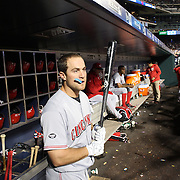 NEW YORK, NEW YORK - APRIL 25: Scott Schebler #43 of the Cincinnati Reds preparing to bat in the dugout during the New York Mets Vs Cincinnati Reds MLB regular season game at Citi Field on April 25, 2016 in New York City. (Photo by Tim Clayton/Corbis via Getty Images)