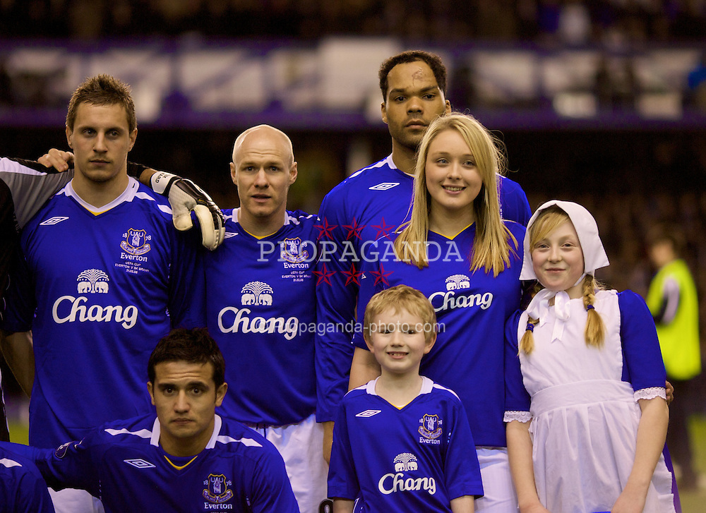 LIVERPOOL, ENGLAND - Thursday, February 21, 2008: Everton's blonde female mascot with Jolean Lescott and Andrew Johnson before the UEFA Cup Round of 32 2nd Leg match against SK Brann Bergen at Goodison Park. (Photo by David Rawcliffe/Propaganda)