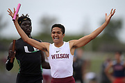 Seaver Cardoza of Long Beach Wilson celebrates after defeating Namir Hemphill of Upland on the anchor of the 4 x 400m relay, 3:13.86 to 3:13.97, during the 2019 CIF Southern Section Masters Meet in Torrance, Calif., Saturday, May 18, 2019.