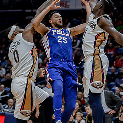 Dec 10, 2017; New Orleans, LA, USA; Philadelphia 76ers guard Ben Simmons (25) is defended by New Orleans Pelicans guard Jrue Holiday (11) and center DeMarcus Cousins (0) during the second half at the Smoothie King Center. The Pelicans defeated the 76ers 131-124. Mandatory Credit: Derick E. Hingle-USA TODAY Sports