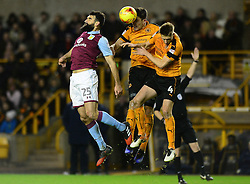 Mile Jedinak of Aston Villa challenges for the ball in the air with  Dave Edwards of Wolverhampton Wanderers - Mandatory by-line: Dougie Allward/JMP - 14/01/2017 - FOOTBALL - Molineux - Wolverhampton, England - Wolverhampton Wanderers v Aston Villa - Sky Bet Championship