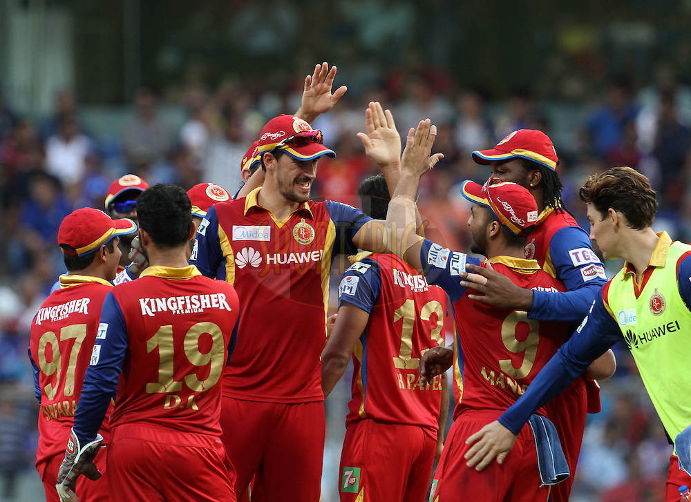 Royal Challengers Bangalore players celebrates the wicket of Mumbai Indians captain Rohit Sharma during match 46 of the Pepsi IPL 2015 (Indian Premier League) between The Mumbai Indians and The Royal Challengers Bangalore held at the Wankhede Stadium in Mumbai, India on the 10th May 2015.<br /> <br /> Photo by:  Vipin Pawar / SPORTZPICS / IPL