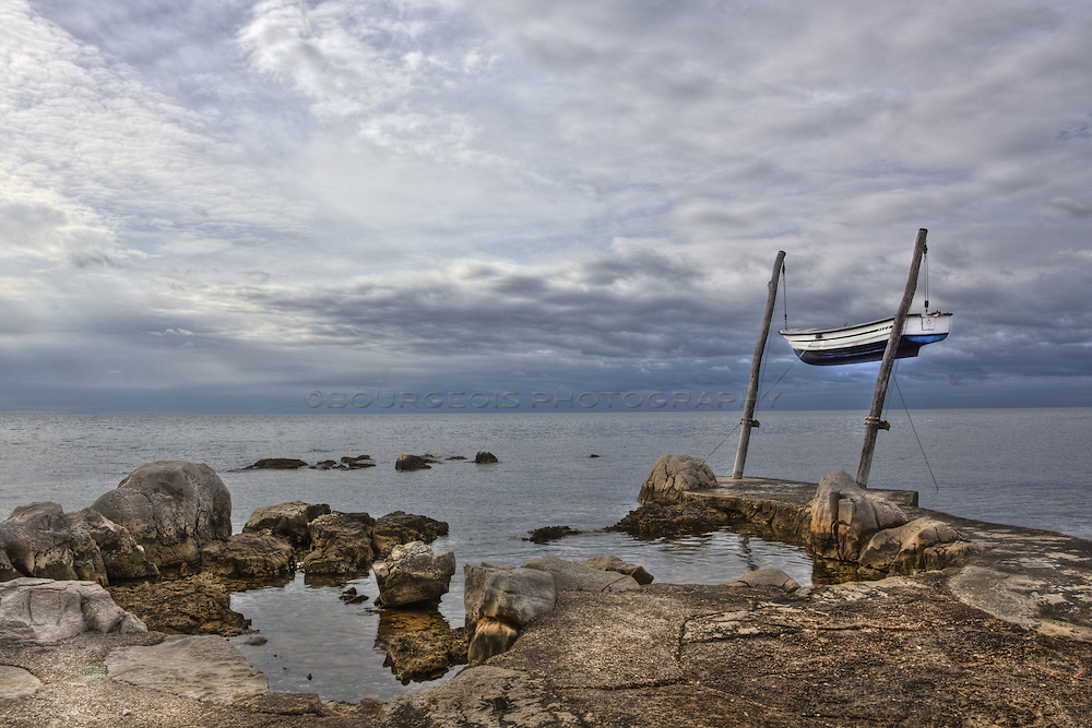 an HDR photo of boat hanging on poles in the Adriatic Sea near Croatia