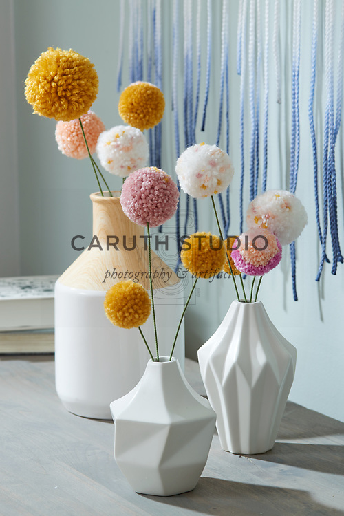 Pom-pom flowers in vases