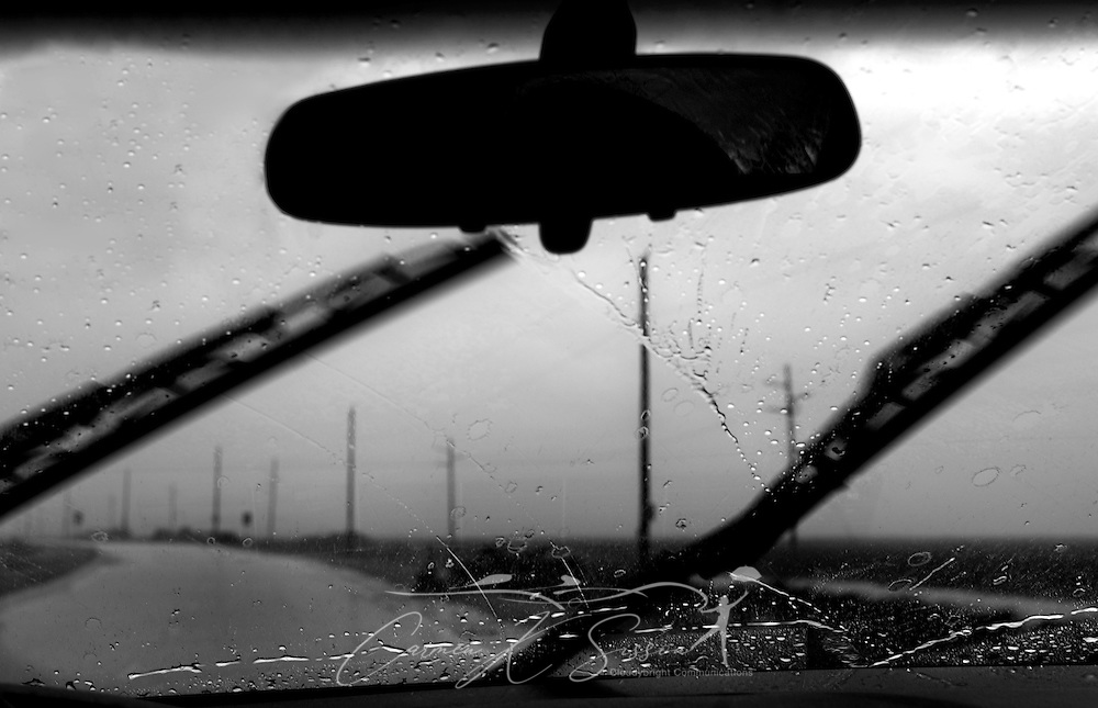 A car drives in the rain as the first feeder bands of Tropical Storm Lee move ashore on Dauphin Island, Alabama Sept. 3, 2011. (Photo by Carmen K. Sisson/Cloudybright)