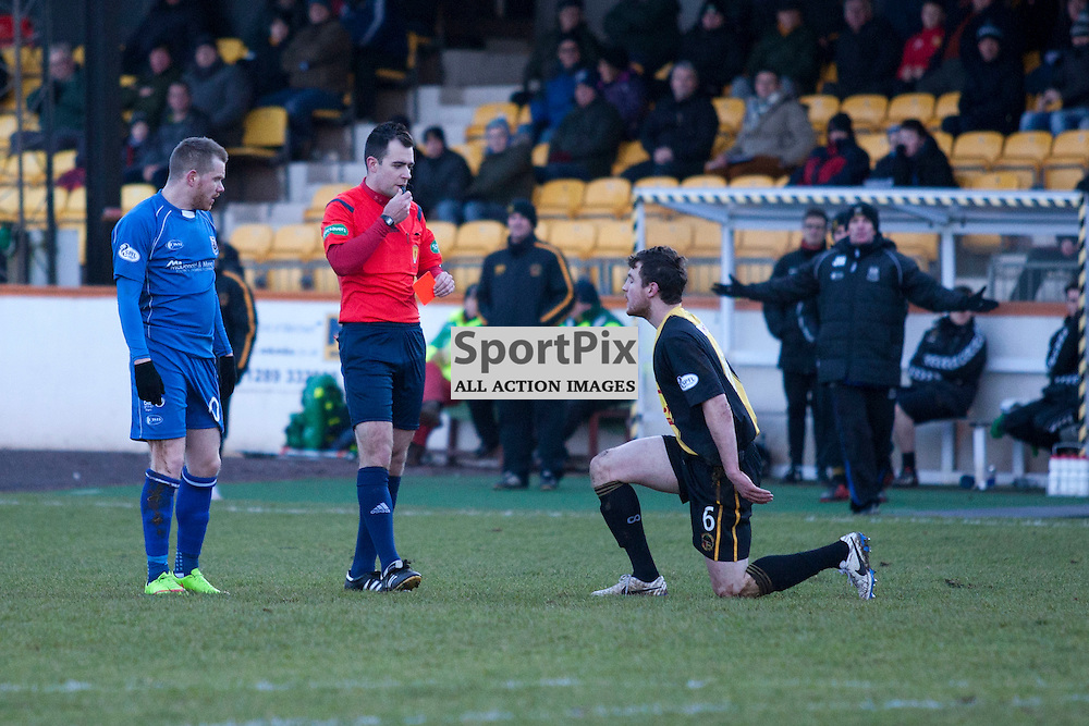 Jonny Fairbairn (Berwick 6) is shown the red card by referee Don Robertson for a foul on Craig Gunn (Elgin 10) in the Berwick Rangers v Elgin City league match at Shielfield Park, Berwick. 31 January 2014<br /><br />(c) Russell G Sneddon / SportPix.org.uk