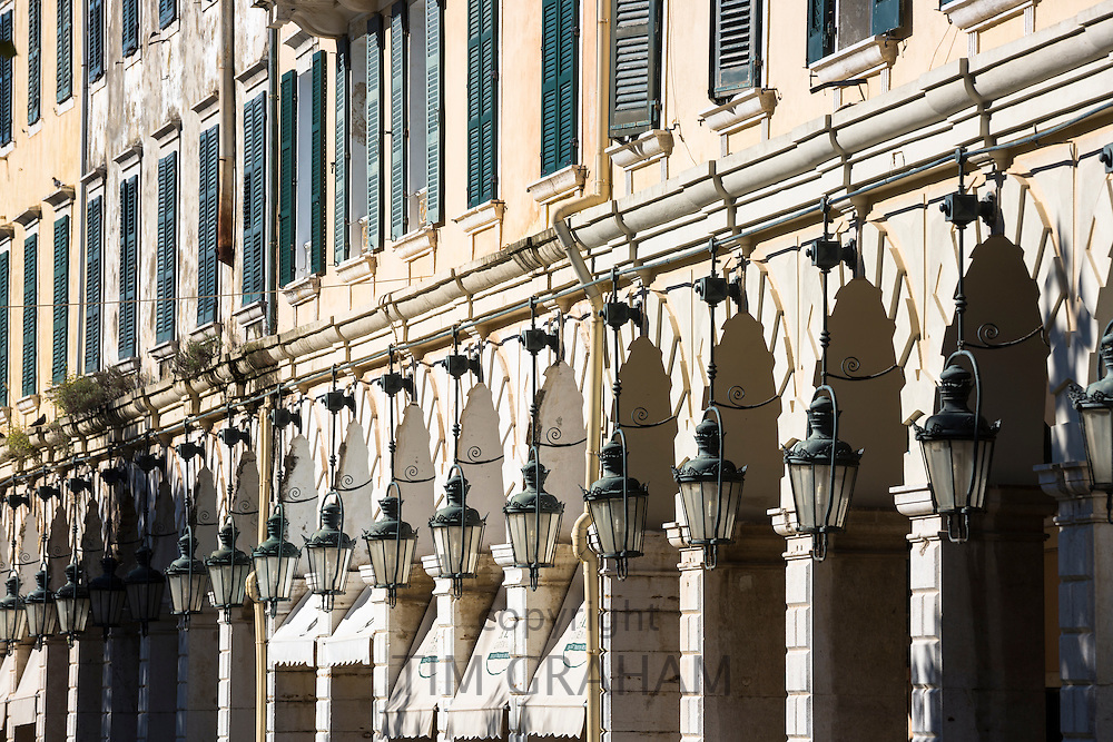 The arcades and traditional lamps of the famous Liston at the Spianada in Kerkyra, Corfu Town, Greece