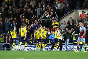 Players and fans celebrate a goal by Matty Taylor (9) of Oxford United (2-0) during the EFL Cup match between Oxford United and West Ham United at the Kassam Stadium, Oxford, England on 25 September 2019.