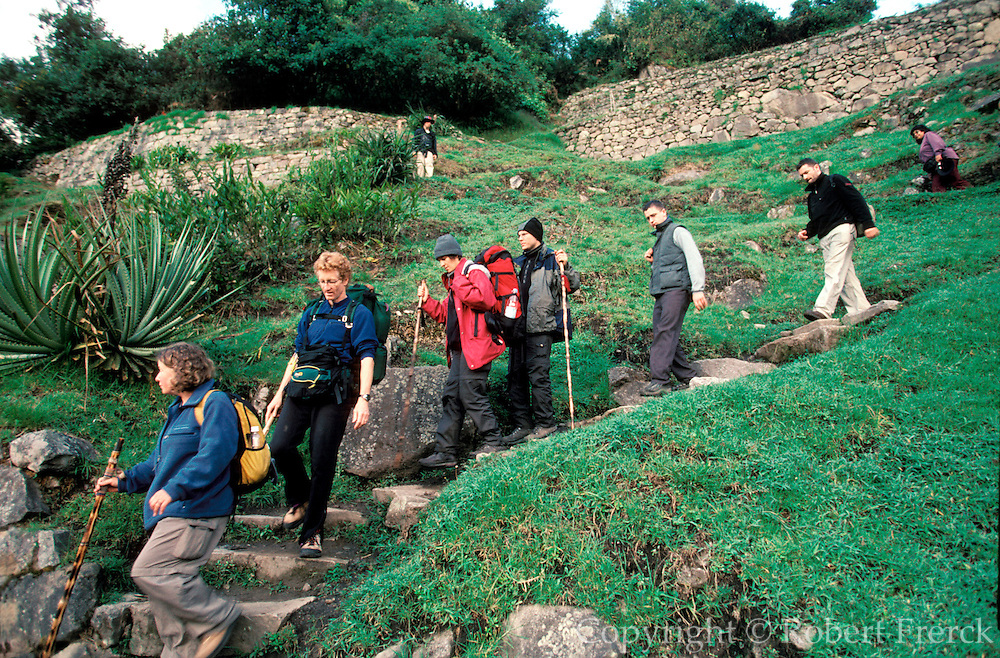 PERU, HIGHLANDS, PREHISPANIC, INCA Machu Picchu; hikers arrive at the ancient city after having completed the trek of the Inca Trail