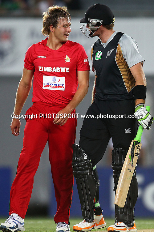 NZ's Martin Guptill has a word with Zimbabwe's Kyle Jarvis. New Zealand Black Caps v Zimbabwe, International Twenty-20 at Eden Park, Auckland, New Zealand. Saturday 11th February. Photo: Anthony Au-Yeung / photosport.co.nz