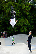 The official opening of the skate park in Cromer which has been campaigned for about 20 years. Pictured is Max Collier performing a backflip on his BMX with Mayor of Cromer Tim Adams looking on.<br /> <br /> Picture: MARK BULLIMORE