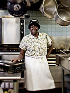 Restaurant cook in the kitchen posing for a portrait.