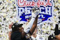 UCF Knights linebacker Shaquem Griffin (18) celebrates beating the Auburn Tigers during the 2018 Chick-fil-A Peach Bowl NCAA football game on Monday, January 1, 2018 in Atlanta. (Daniel Shirey / Abell Images for the Chick-fil-A Peach Bowl)