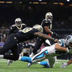 Jan 7, 2018; New Orleans, LA, USA; Carolina Panthers tight end Greg Olsen (88) dives for extra yardage against New Orleans Saints free safety Vonn Bell (48) during the first quarter in the NFC Wild Card playoff football game at Mercedes-Benz Superdome. Mandatory Credit: Derick E. Hingle-USA TODAY Sports