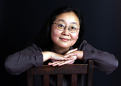 Feature on Aiping Mu, daughter of a couple who were high ranking in China but subsequently fell out of favour. Aiping Mu has written  book 'Vermillon Gate.' Collects of Aiping's Father. October 10, 2000 Photo by Andrew Parsons/i-Images.