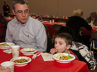 "Kyril Mitchell watches as his son Owen enjoys a bowl of Japanese Udon Noodle soup during Sunday's ""Soupathon"" for Hands Across the Table.  (Karen Bobotas/for the Laconia Daily Sun)"