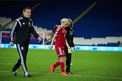 CARDIFF, WALES - Tuesday, August 21, 2014: Wales' manager Jarmo Matikainen, captain Jessica Fishlock and coach Kath Morgan dejected after losing 4-0 to England during the FIFA Women's World Cup Canada 2015 Qualifying Group 6 match at the Cardiff City Stadium. (Pic by David Rawcliffe/Propaganda)