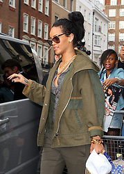 Singer Rihanna checks out of her hotel in London wearing a green jacket, grey top, green trousers and a pair of white Stilettos and heads to St Pancras station to catch the Eurostar. UK. 01/09/2012<br />BYLINE MUST READ : GOTCHAIMAGES.COM<br /><br />Copyright by © Gotcha Images Ltd. All rights reserved.<br />Usage of this image is conditional upon the acceptance <br />of Gotcha Images Ltd, terms and conditions available at<br />www.gotchaimages.com