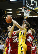 January 19 2013: Wisconsin Badgers forward Zach Bohannon (34), Iowa Hawkeyes center Adam Woodbury (34), and Wisconsin Badgers forward Mike Bruesewitz (31) battle for a rebound during the first half of the NCAA basketball game between the Wisconsin Badgers and the Iowa Hawkeyes at Carver-Hawkeye Arena in Iowa City, Iowa on Sautrday January 19 2013. Iowa defeated Wisconsin 70-66.
