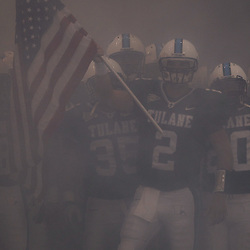 Sep 11, 2010; New Orleans, LA, USA; Tulane Green Wave quarterback Kevin Moore (2) holds an American flag prior to running onto the field for kickoff of a game between the Mississippi Rebels and Tulane Green Wave at the Louisiana Superdome.  Mandatory Credit: Derick E. Hingle