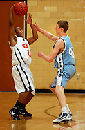 4 FEB. 2010 -- WEBSTER GROVES, Mo. -- Webster Groves' James Kenner (11) loses control of the ball to Parkway West's Tyler Yess (45, CQ) the game Thursday, Feb. 4, 2010 between Webster Groves and Parkway West at Webster Groves High School. Photo (c) copyright by Sid Hastings.