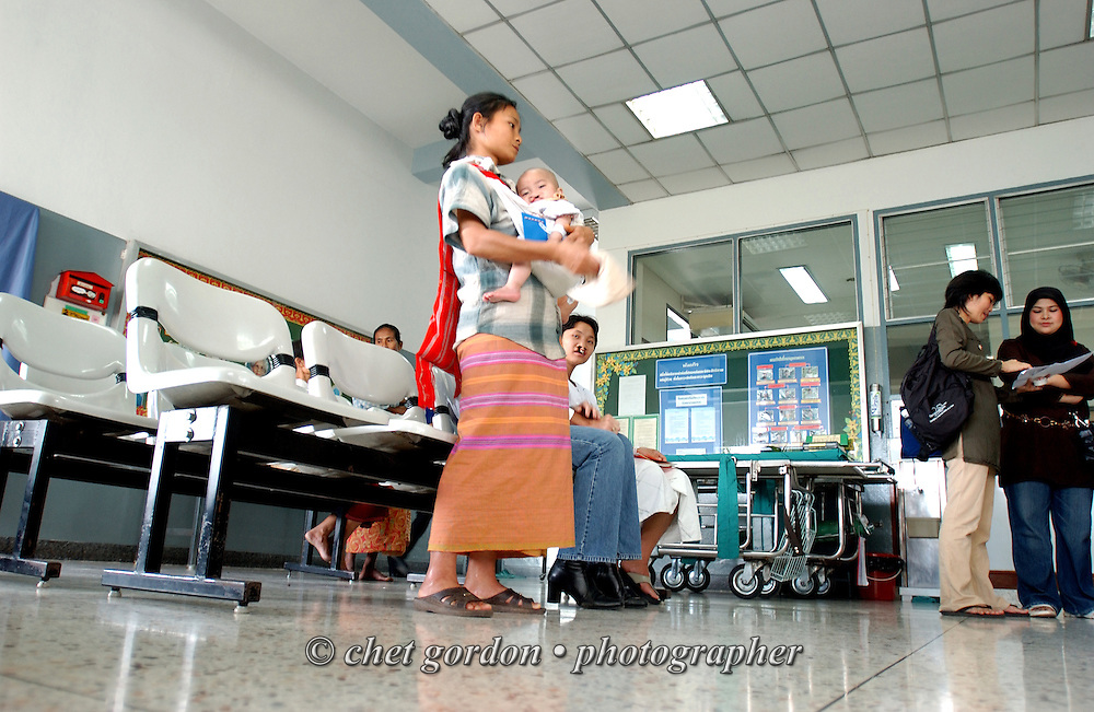 A 25 year-old Thai mother and her 18-month old son wait during the first day of surgery at Mae Sot General Hospital in Mae Sot, Thailand on Monday, November 12, 2007.  © Chet Gordon for Operation Smile