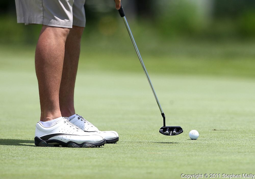 Joey Lamielle of Sarasota, Florida putts the ball on the 9th hole during the first round of the Greater Cedar Rapids Open held at Hunters Ridge Golf Course in Marion on Friday, July 22, 2011.