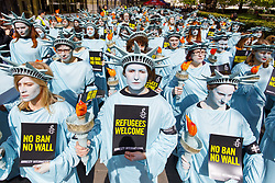 April 27, 2017 - London,United kingdom - One hundred Amnesty International activists dressed as 'Statues of Liberty' protest outside the US Embassy in London to mark US President Donald Trump's first 100 days in office. (Credit Image: © Tolga Akmen/London News Pictures via ZUMA Wire)