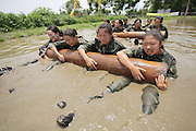 CHENGDU, CHINA - JUNE 14: (CHINA OUT) <br /> <br /> Prospective flight attendants of Chengdu East Star Airlines College take military training on June 14, 2016 in Chengdu, Sichuan Province of China. 20 prospective flight attendants from Chengdu East Star Airlines College attended a military training including creeping in water, raising logs, combat and wrestling to prepare for dealing with emergency situations on aircraft. <br /> ©Exclusivepix Media