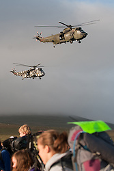 © licensed to London News Pictures. Okehampton, UK  14/05/2011 Military helicopters fly past as thousands of young people take part in the 2011 Ten Tors event on Dartmoor. Please see special instructions for usage rates. Photo credit should read London News Pictures