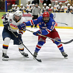 WELLINGTON, ON - JANUARY 25: Daniel Panetta #12 of the Wellington Dukes and Tyler Amaral #8 of the Oakville Blades skates up ice in the third period on January 25, 2019 at Wellington and District Community Centre in Wellington, Ontario, Canada.<br /> (Photo by Ed McPherson / OJHL Images)