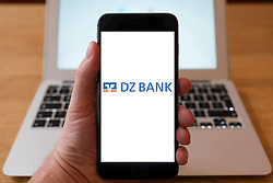 Using iPhone smart phone to display website logo of DZ Bank, a German Bank
