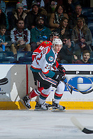 KELOWNA, CANADA - JANUARY 28: Braydyn Chizen #22 of the Kelowna Rockets checks Jake Gricius #14 of the Portland Winterhawks into the boards on January 28, 2017 at Prospera Place in Kelowna, British Columbia, Canada.  (Photo by Marissa Baecker/Shoot the Breeze)  *** Local Caption ***